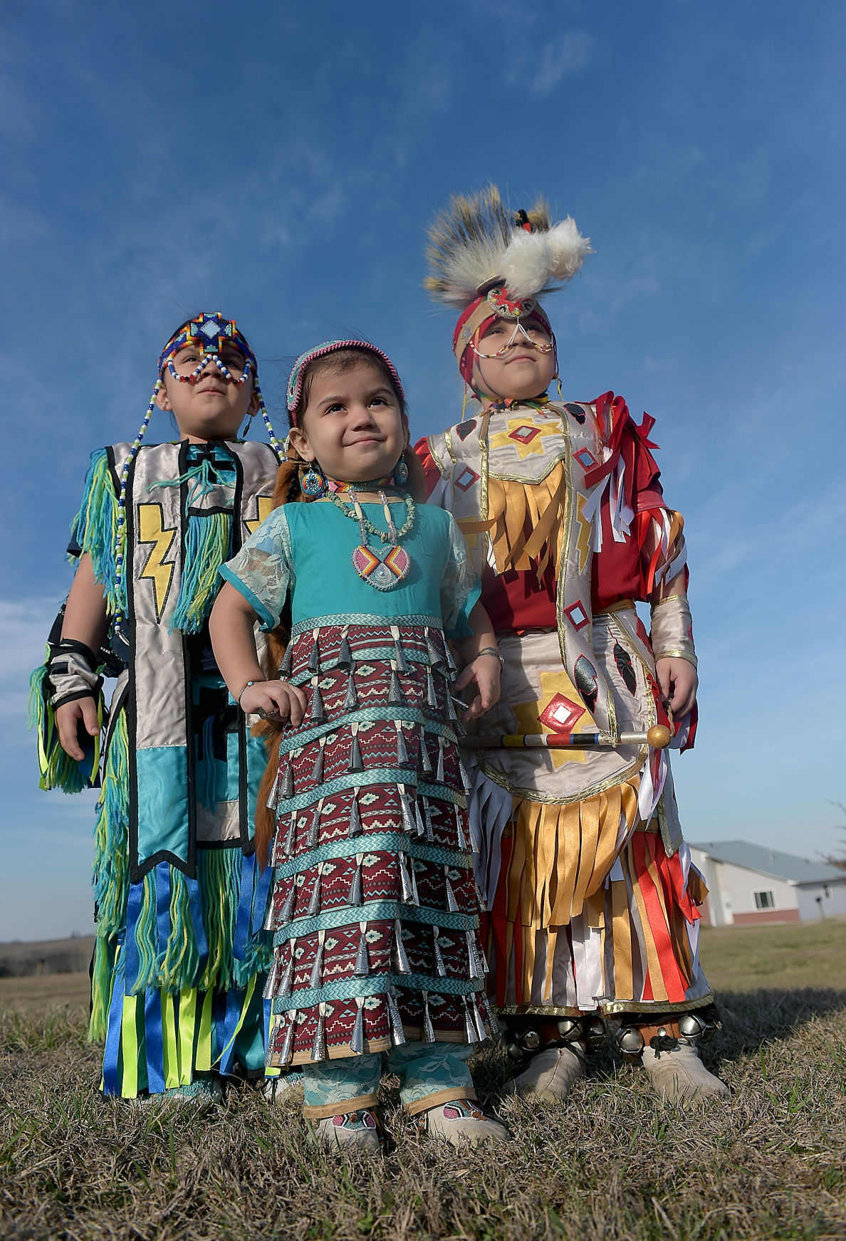 From left, Naash-Niish Garza 6, Shi-bah-sii-kwe Garza 3 and Komoah Garza 7, display handmade regalia. The siblings are a third generation to attend Kickapoo Nation School in Powhattan. They live on the reservation with their parents. Jessica Stewart, St.